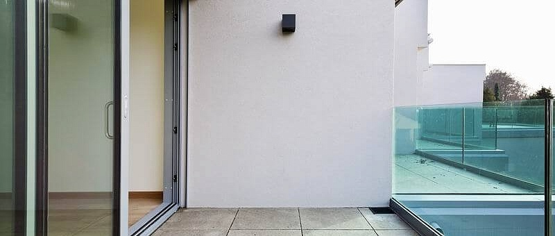 Пластиковые раздвижные двери на балкон